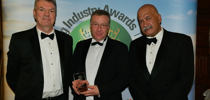 Andrew Goodison (centre) with Adrian Gough of Du Pont (category sponsor) and John Pienaar (Guest speaker)