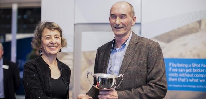 Jim Aitkin receives his award from Sara Churchill