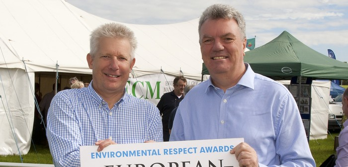 Peter Clare from ECM (left) receives his award from Adrian Gough of Corteva