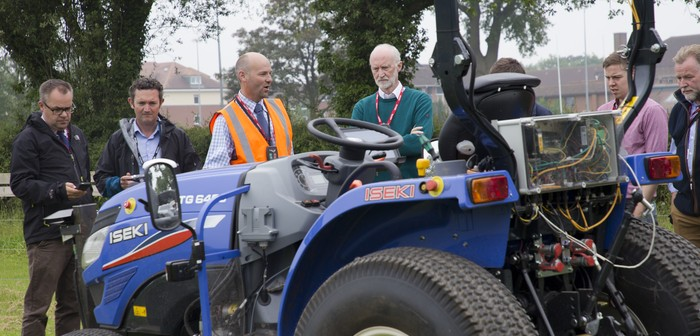 Mike Gutteridge (from Harper Adams University and HFHa team) shares the modifications that have been made to the HFHa tractor with the participants: