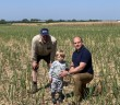 Rob Meadley, his father and son on Miscanthus field early June 2020