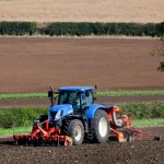 Tractor drilling in mineral soil