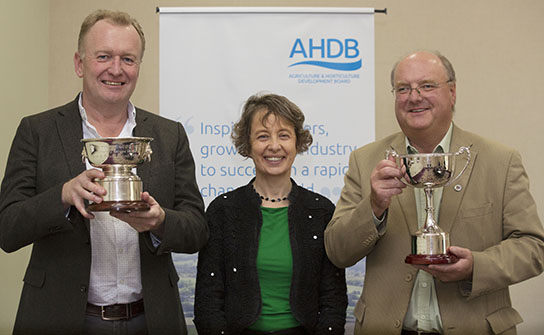 Former chair of the Potato Sector Board Sophie Churchill (centre) presents the 2018 awards to Gerard Croft, now chair of the British Potato Trade Association, (right) and Doug Harley (left), managing director of Cygnet.